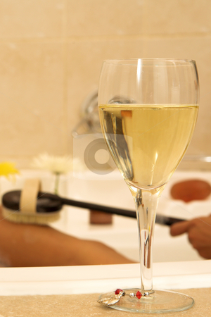 Woman #77 stock photo, Nude woman in a bath with wineglass in the foreground.  Shallow D.O.F by Sean Nel