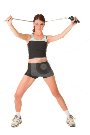 Gym #164 stock photo, Woman in gym wear holding skipping rope behind her head. by Sean Nel