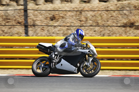 Superbike #63 stock photo, High speed Superbike on the circuit  by Sean Nel