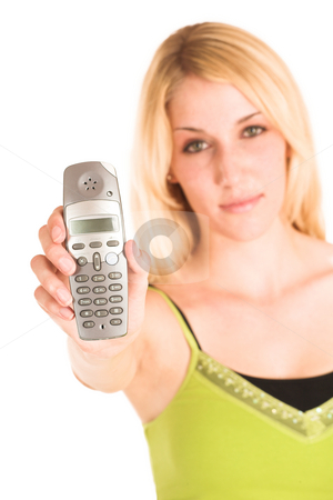 Businesswoman #457 stock photo, Blonde business lady in an informal green top. Holding a telephone.  Shallow DOF - phone in focus, face out of focus. by Sean Nel