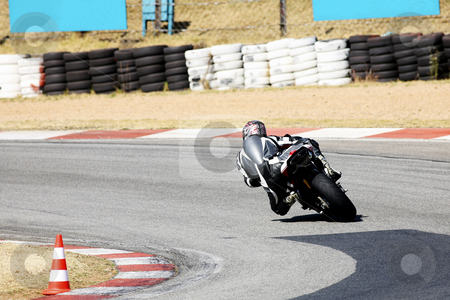 Superbike #86 stock photo, High speed Superbike on the circuit  by Sean Nel