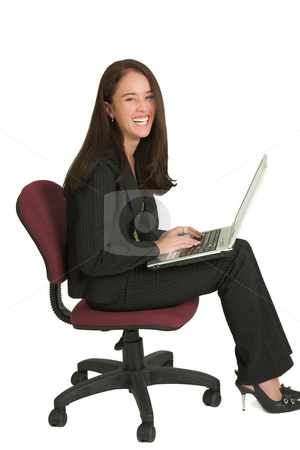 Business Woman #541 stock photo, Portrait of a brunette business woman, sitting on an office chair, working on a laptop, lauging by Sean Nel