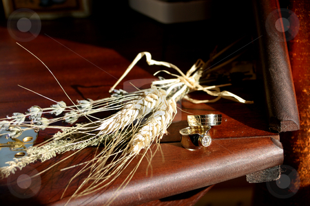 Wedding rings and wheat stock photo, Wedding rings on the table by Sean Nel
