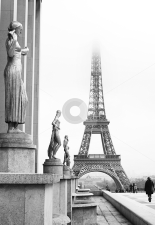 Paris #66 stock photo, A golden statue in the foreground with the Eiffel Tower in Paris, France. Black and white.   Copy space. by Sean Nel