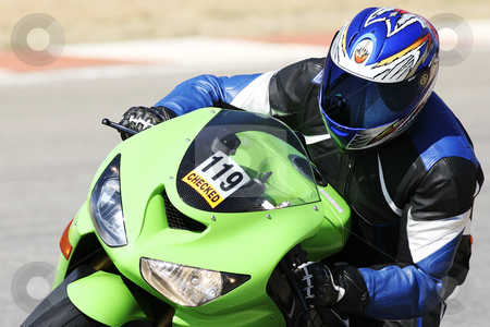 Superbike #55 stock photo, High speed Superbike on the circuit  by Sean Nel
