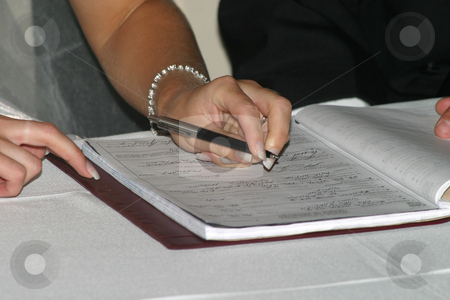 Signing the register stock photo, New bride signing the register by Sean Nel