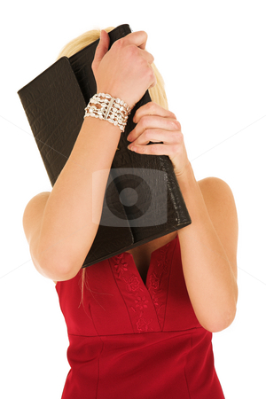 Blonde businesswoman hiding behind folder stock photo, Young blonde adult businesswoman, hiding behind leather document folder. Isolated on white by Sean Nel