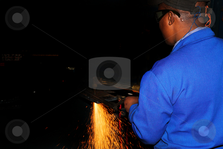 Plasma Cutter #2 stock photo, Worker in blue safety wear, working with Plasma cutter - Focus on person, not on sparks by Sean Nel