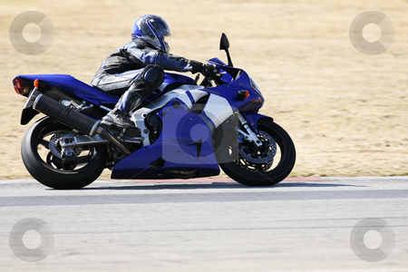 Superbike #77 stock photo, High speed Superbike on the circuit  by Sean Nel
