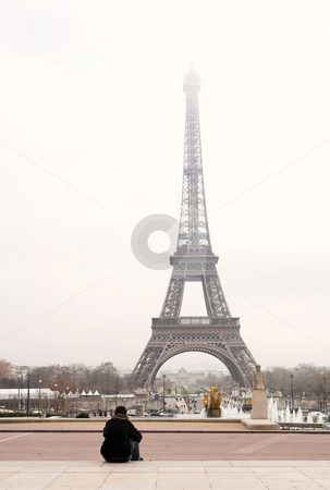 Paris #42 stock photo, A person sitting, looking at the Eiffel Tower in Paris, France.  Copy space. by Sean Nel