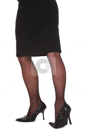 Sexy legs of a businesswoman stock photo, Sexy legs of a business woman in black stocking with high heels by Sean Nel