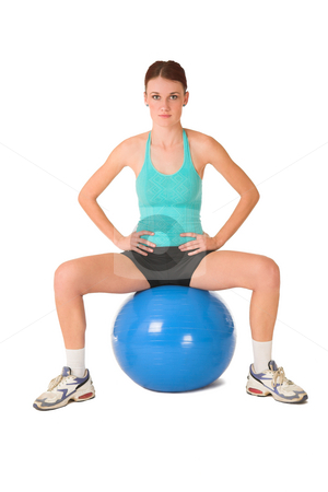Gym #183 stock photo, Woman sitting on gym ball with hands on her hips. by Sean Nel