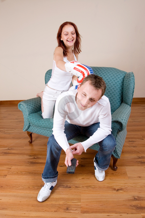 Couple #46 stock photo, Woman hitting her boyfriend with boxing gloves by Sean Nel