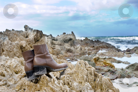 Shoes #14 stock photo, Brown leather boots on the rocks at the sea by Sean Nel