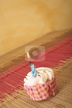 Cupcakes #6 stock photo, One cupcake on pink and brown table cloth in front of  wall - scew camera angle, copy space by Sean Nel