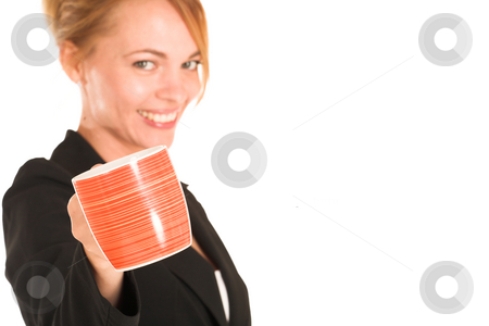 Businesswoman #251 stock photo, Blonde business lady in formal black suit. Holding a mug.  Shallow DOF, mug in focus, face out of focus. Copy space by Sean Nel