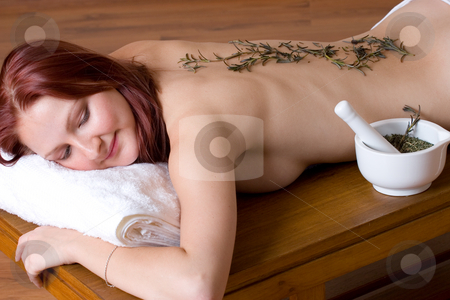 Massage #15 stock photo, Woman lying on massage table with lavender twigs on clean naked back - Eyes Closed by Sean Nel