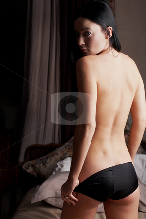 Intimate young lovers stock photo, Young adult Caucasian woman undressing  during sexual foreplay by Sean Nel