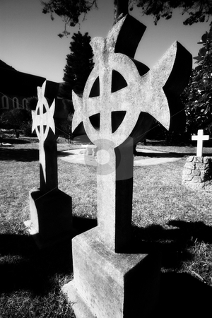 Headstone grave marker stock photo, Irish Cross shaped old headstone of a grave made from granite by Sean Nel