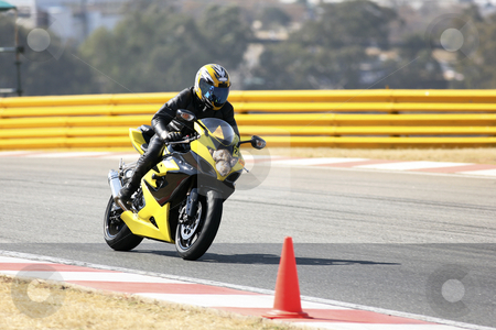 Superbike #81 stock photo, High speed Superbike on the circuit  by Sean Nel