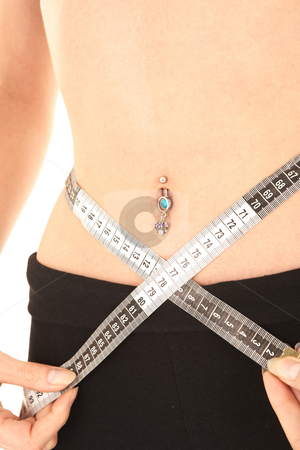 Fitness Equipment stock photo, Sexy young Caucasian adult woman with measuring tape around her waist and a navel piercing by Sean Nel