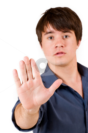 Businessman #53 stock photo, Businessman in blue shirt, holding up hand - hand in focus, eyes out of focus by Sean Nel