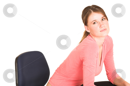 Businesswoman #415 stock photo, Brunette business lady in pink top.  Sitting on office chair - copy space by Sean Nel