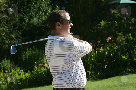 Staring golfer stock photo, Looking at his shot by Sean Nel