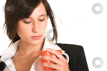 Business Woman #279 stock photo, Business woman dressed in a pencil skirt and jacket.  Holding a mug - lookig down. by Sean Nel
