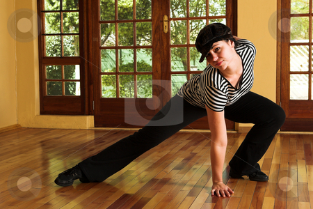 Sexy modern dancer in Black hat and striped top stock photo, Modern Dancer in black Hat and striped top - Practicing in Studio by Sean Nel