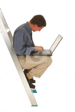 Businessman #44 stock photo, Man sitting on ladder working on laptop. by Sean Nel