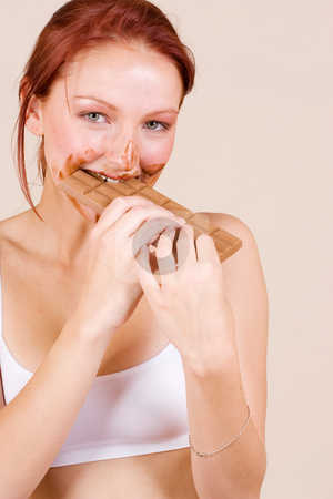 Chocolate #1 stock photo, Redheaded girl eating chocolate by Sean Nel