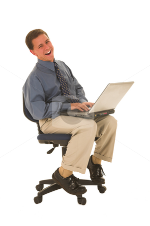 Businessman #50 stock photo, Man sitting on chair working on a laptop. by Sean Nel