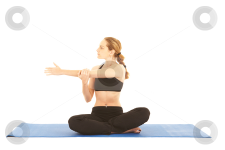 Pilates exercise series stock photo, Fit young brunette pilates instructor showing different exercises on a white background with basic pilates equipment ion a yoga mat. White background, NOT ISOLATED by Sean Nel