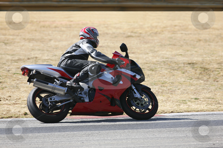 Superbike #70 stock photo, High speed Superbike on the circuit  by Sean Nel