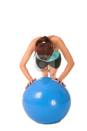 Gym #172 stock photo, Woman in gym wear bending down on blue ball. by Sean Nel