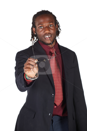 Handsome African businessman stock photo, Handsome African businessman in colorful suit holding his glasses on white background. NOT ISOLATED by Sean Nel