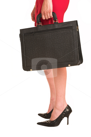 Business Woman #16 stock photo, Business woman dressed in a red skirt.  Holding a leather suitcase by Sean Nel