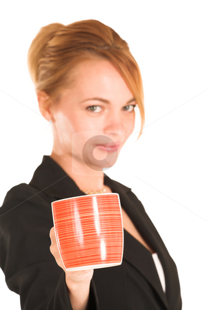 Businesswoman #250 stock photo, Blonde business lady in formal black suit. Holding a mug.  Shallow DOF, mug in focus, face out of focus. by Sean Nel