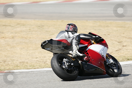 Superbike #85 stock photo, High speed Superbike on the circuit  by Sean Nel
