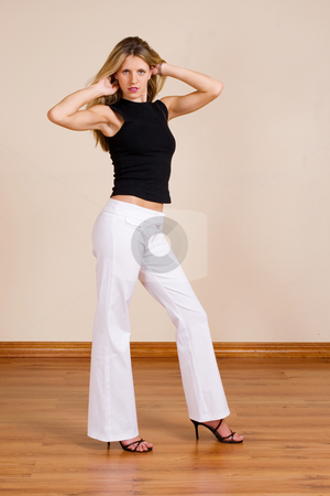 Woman #13 stock photo, Beatiful blonde woman with white pants and a black top by Sean Nel