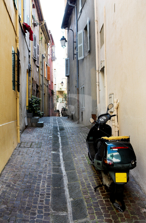 Backstreet scooter stock photo, Black scooter on the backstreets of Cannes, France - Right back lights broken by Sean Nel