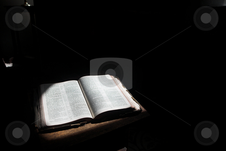 Open bible lying on a table  stock photo, Old open bible lying on a wooden table in a beam of sunlight (not an isolated image) Shallow Depth of field  by Sean Nel