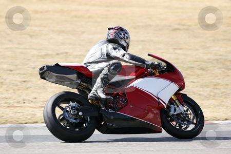 Superbike #74 stock photo, High speed Superbike on the circuit  by Sean Nel