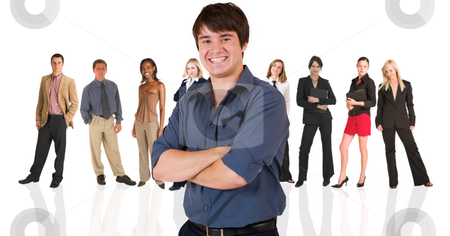 Young businessman standing in front of a business people group stock photo, Handsome young businessman standing in front of a group of business people all isolated on white. The whole group consists of multiracial young adults. The foreground is in sharp focus with the people in the background slightly blurred. by Sean Nel