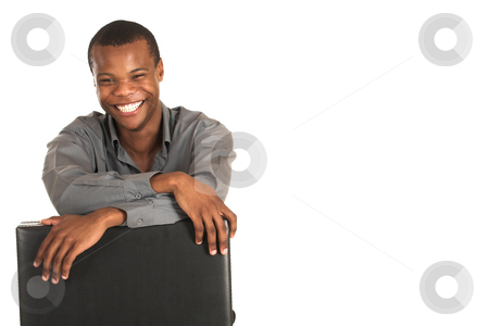 Businessman #145 stock photo, Businessman with grey shirt.  Holding a leather suitcase, smiling.  Copy space. by Sean Nel