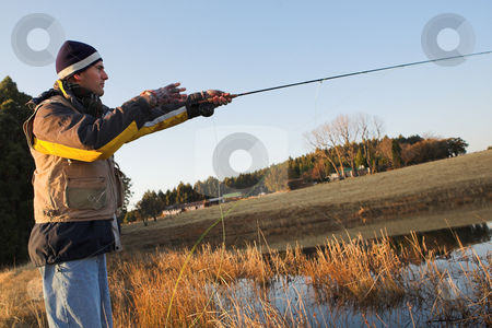 Flyfishing #17 stock photo, A fly fisherman casting a line in Dullstroom, South Africa by Sean Nel