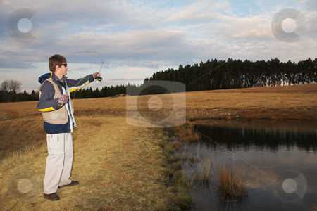 Flyfishing #12 stock photo, A fly fisherman casting a line in Dullstroom, South Africa by Sean Nel