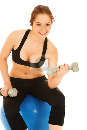 Woman in black with weights stock photo, Isolated young adult Caucasian woman doing curls with weights while sitting on blue gym ball by Sean Nel