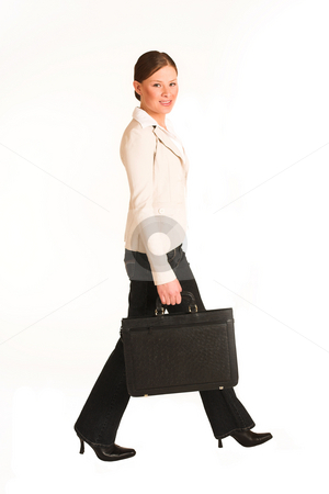Business Woman #223(GS) stock photo, Business woman dressed in jeans and a beige jacket.  Walking.  Movement by Sean Nel